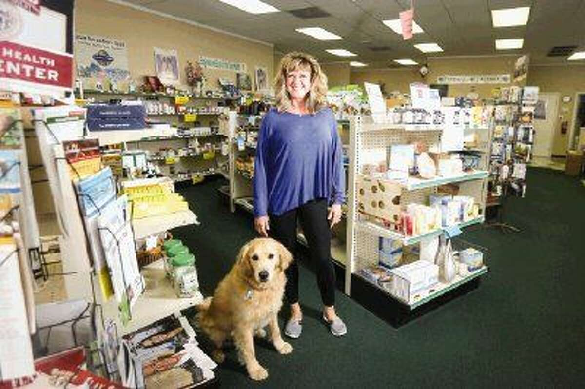 Cheryl Kainer, pictured with her dog Tanner, opened The Woodlands Health Market in 1999 in part to serve her iridology clients, but also to provide the community with other alternative means of health care.