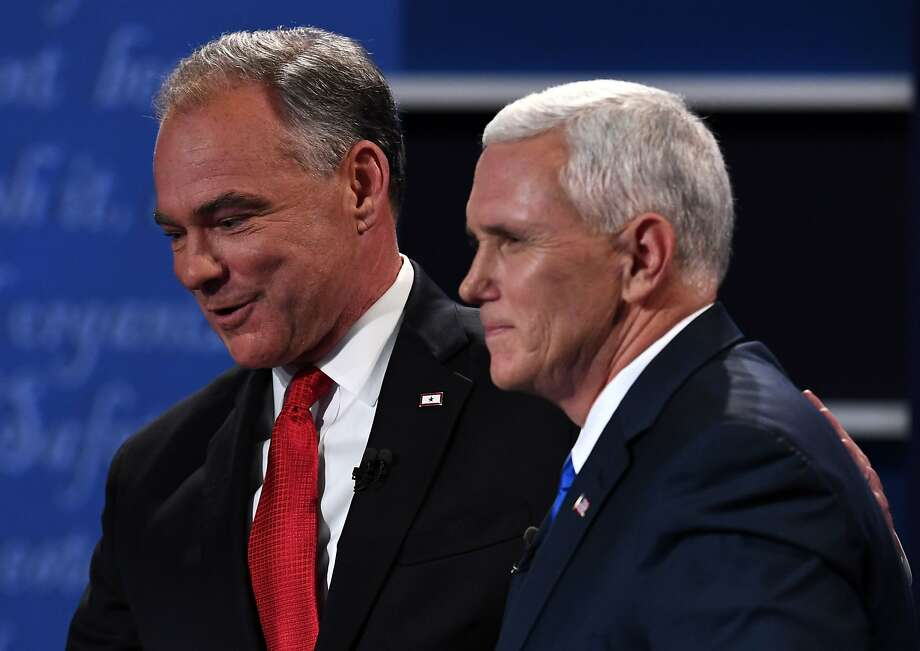 Democratic candidate for Vice President Tim Kaine (L) shakes hands with Republican candidate for Vice President Mike Pence after the vice presidential debate at Longwood University in Farmville, Virginia on October 4, 2016. / AFP PHOTO / Jewel SAMADJEWEL SAMAD/AFP/Getty Images Photo: JEWEL SAMAD, AFP/Getty Images