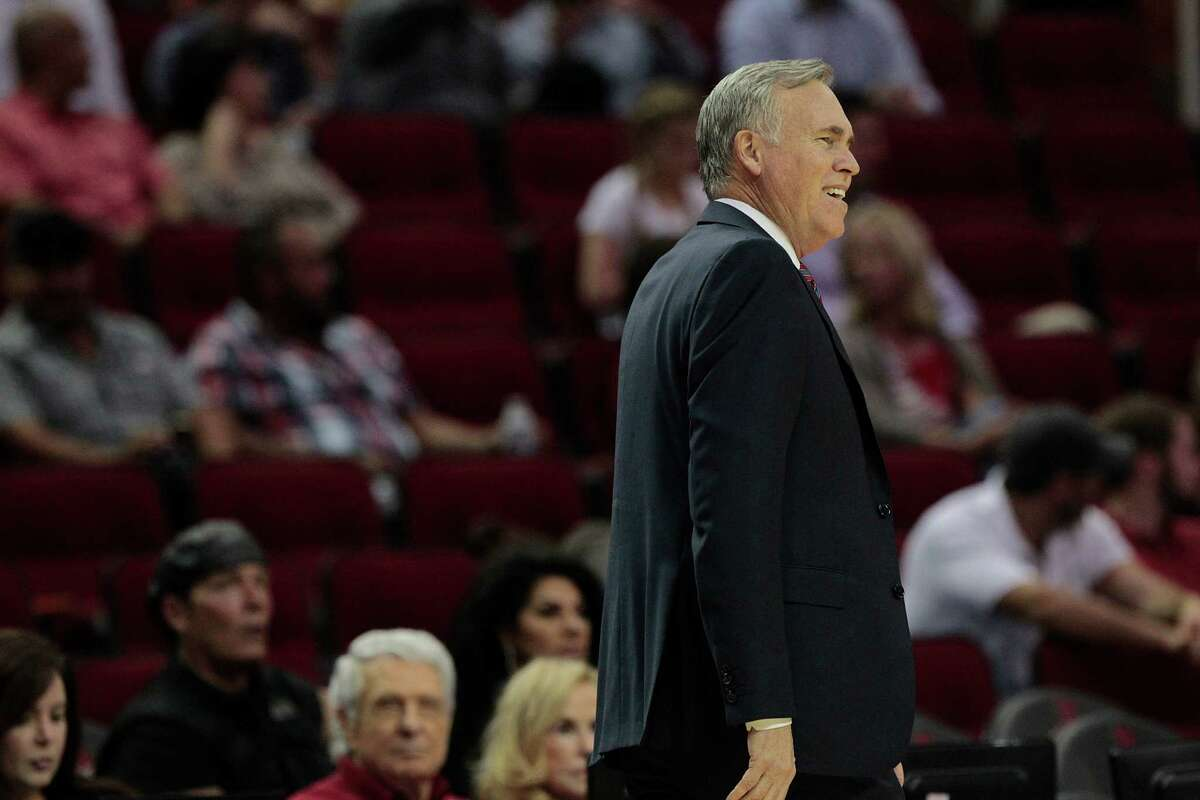 Houston Rockets head coach Mike D'Antoni smiles during a call in the first half against New York Knicks on Tuesday, Oct. 4, 2016, in Houston.