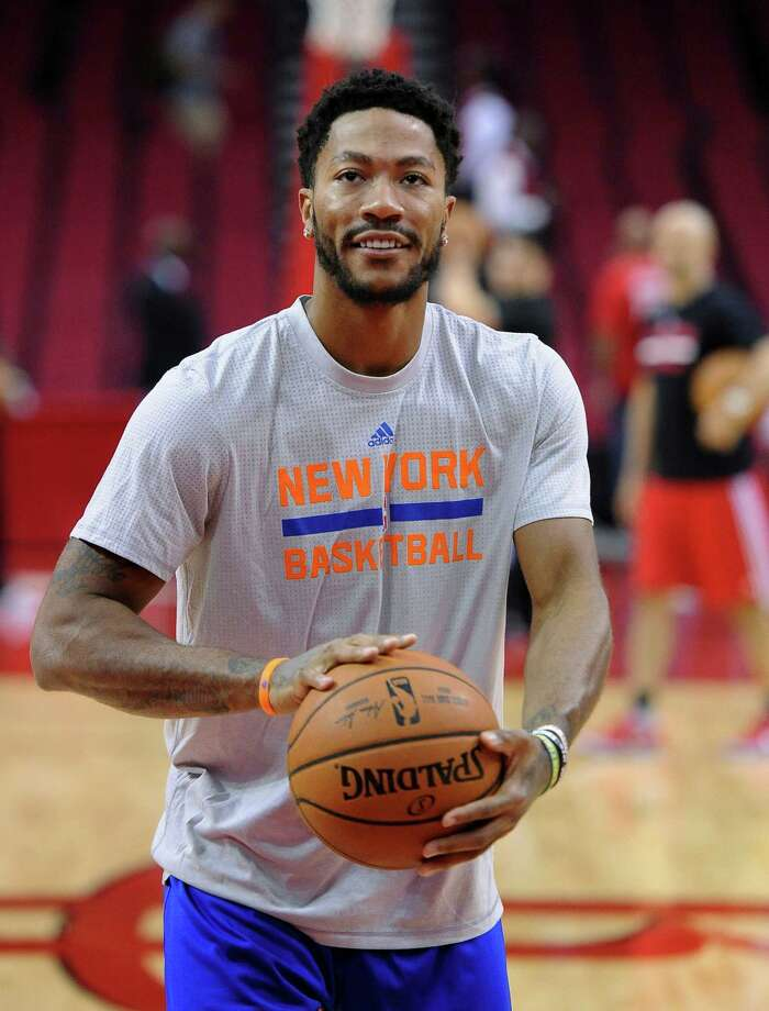 f66cbe7c787d New York Knicks guard Derrick Rose warms up before facing the Houston  Rockets in an NBA