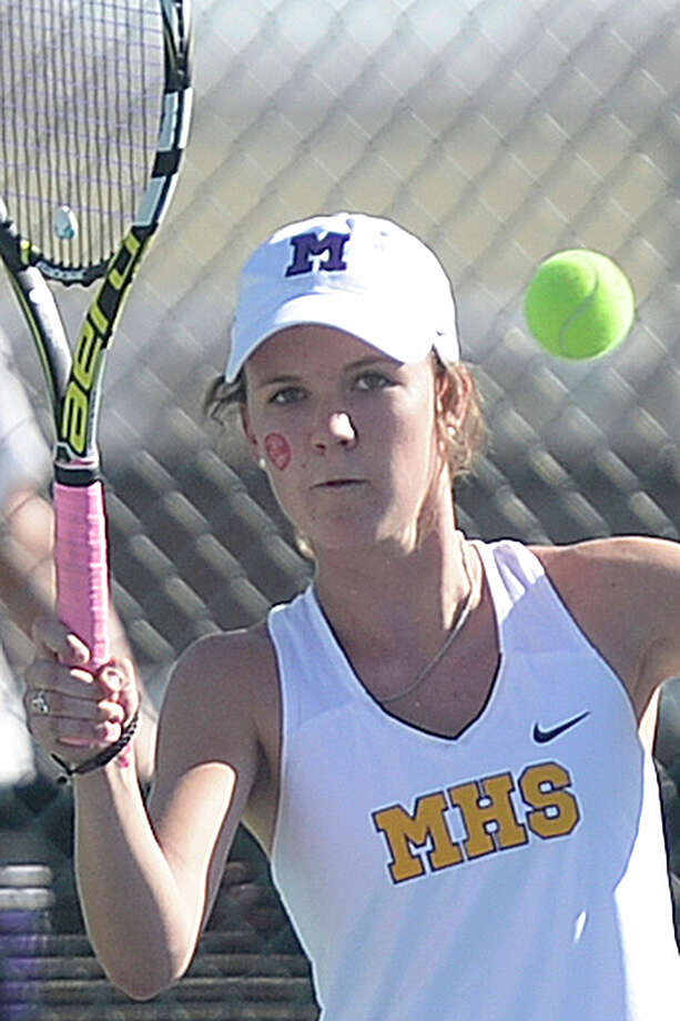 Midland High senior Anna Parkinson competes in a No. 3 singles match against Lee's Ashley Lawrence on Tuesday, Oct. 4, 2016, at Bush Tennis Center.