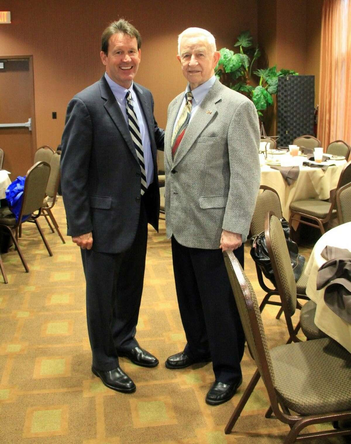 Mayor Tom Reid, right, here with assistant city manager Jon Branson, has led Pearland for 34 years.