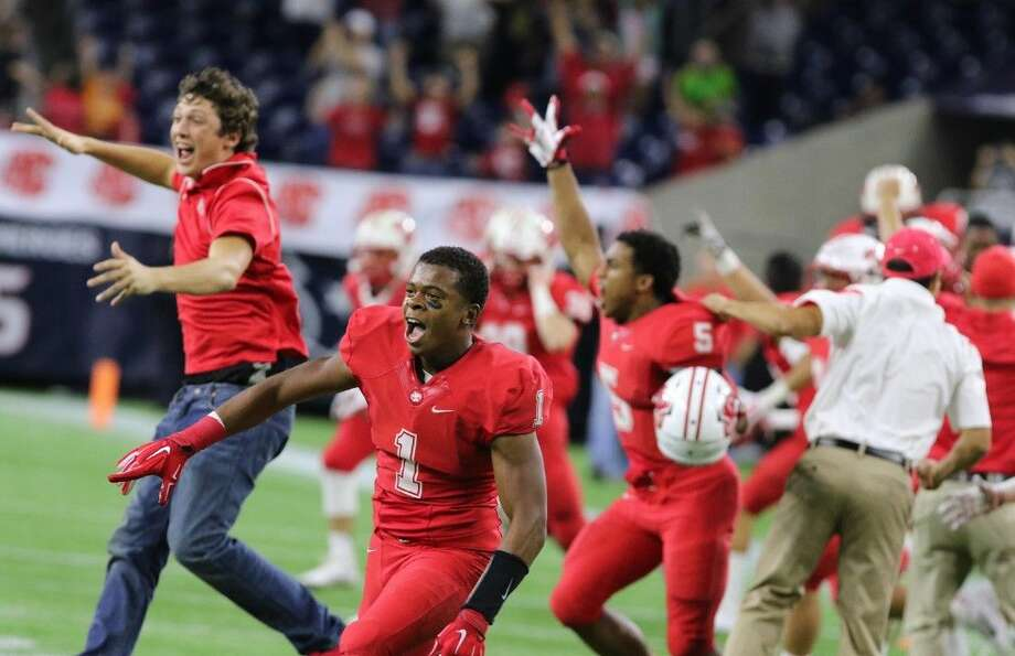 Katy's Tony Mullins and the Katy bench celebrate the 27-20 overtime win over Cibolo Steele during the Class 6A Division II Semifinal, Dec. 13 at NRG Stadium in Houston. Photo: Alan Warren