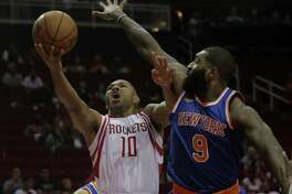 Rockets guard Eric Gordon tries to fend off the Knicks' Kyle O'Quinn while driving in the first half Tuesday night at Toyota Center.