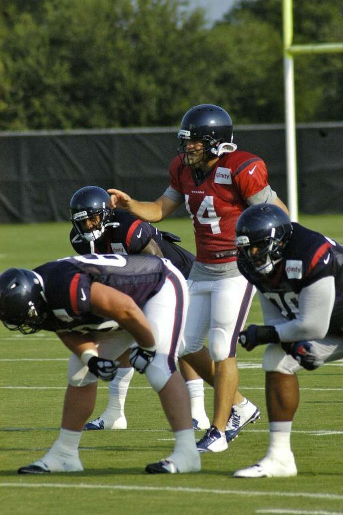 Texans starting QB Ryan Fitzpatrick gives signals during practice at the Houston Methodist Training Center.