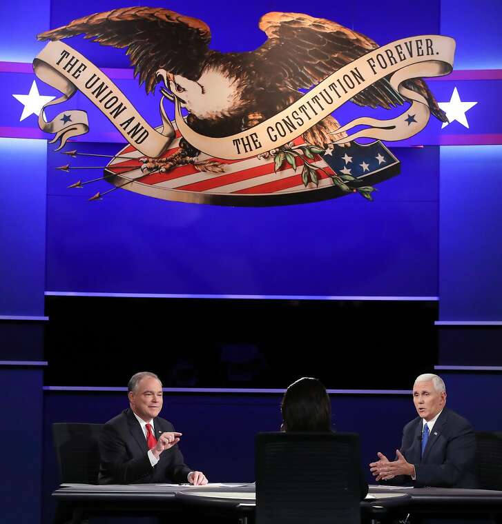 FARMVILLE, VA - OCTOBER 04:  Democratic vice presidential nominee Tim Kaine (L) and Republican vice presidential nominee Mike Pence (R) debate as moderator Elaine Quijano (C) listens during the Vice Presidential Debate at Longwood University on October 4, 2016 in Farmville, Virginia.  This is the second of four debates during the presidential election season and the only debate between the vice presidential candidates.  (Photo by Mark Wilson/Getty Images)