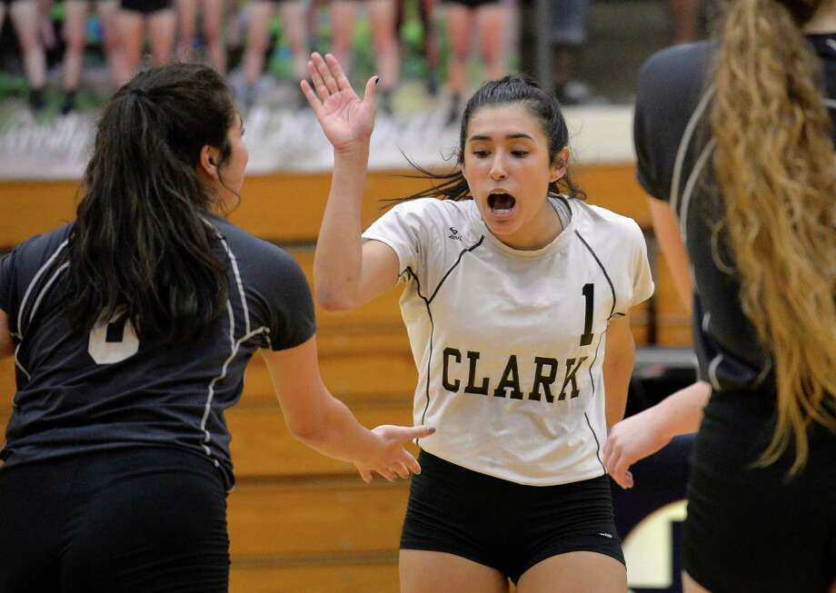 Clark players Mia Ybarra (1) and Miranda Mendez celebrate a point during a high school volleyball match against Brandeis, Tuesday, Oct. 4, 2016, in San Antonio. (Darren Abate/For the Express-News) Photo: Darren Abate / For The Express-News / San Antonio Express-News
