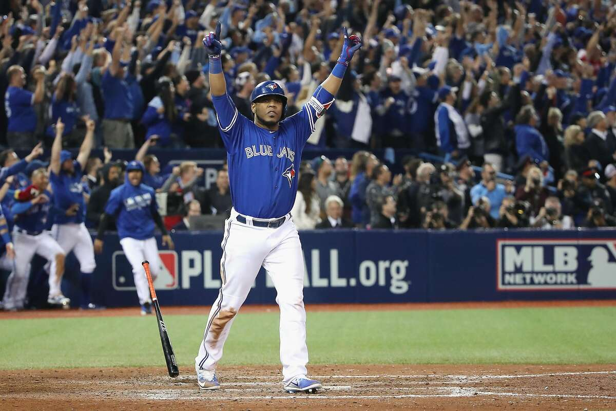 TORONTO, ON - OCTOBER 04: Edwin Encarnacion #10 of the Toronto Blue Jays reacts after hitting a three-run walk-off home run in the eleventh inning to defeat the Baltimore Orioles 5-2 in the American League Wild Card game at Rogers Centre on October 4, 2016 in Toronto, Canada. (Photo by Tom Szczerbowski/Getty Images)