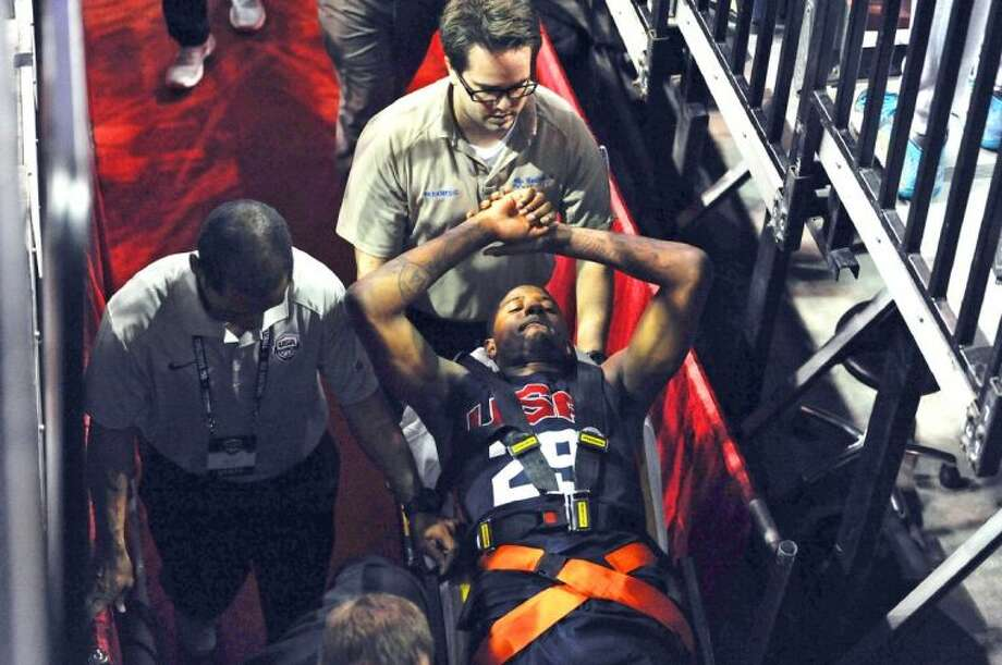 Paul George gets wheeled off the court after sustaining a compound fracture in his right leg on Friday night in Las Vegas.