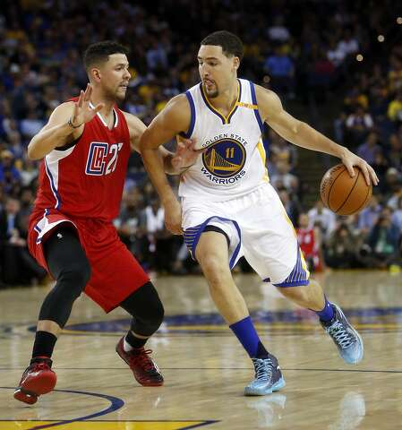 fbb3288a507 Golden State Warriors  Klay Thompson drives against Los Angeles Clippers   Austin Rivers in 1st