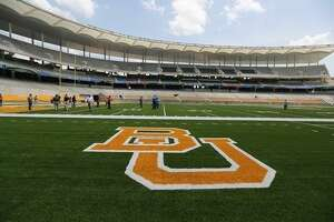 FILE - This Aug 2014 file photo shows the Baylor University logo on the football field at McLane Stadium in Waco, Texas. A long-running spat between the world's largest Baptist school and the Baylor Alumni Association over actions the school claims is hurting its brand is scheduled for a January court showdown over civil lawsuits each has filed against the other.