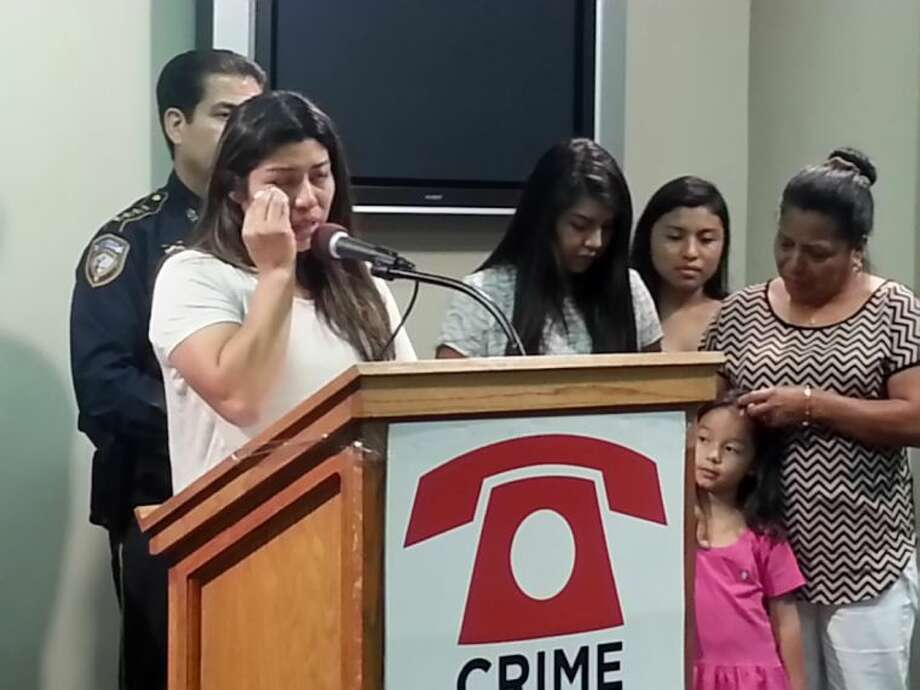 Family members of Tony Munguia address the media after it was announced the Crime Stoppers of Houston was increasing the award for information about the death of Munguia in July of 2013.
