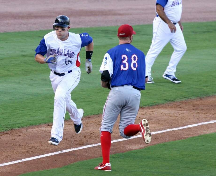 Sugar Land's Travis Scott scores during the Atlantic League All-Star Game, July 16 at Constellation Field in Sugar Land. The Skeeters completed their most recent homestand in first place. Photo: Alan Warren