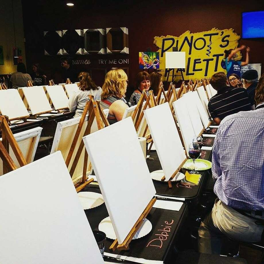 Guests prepare to paint at the Media Night celebration for the grand opening for Pinot's Palette in Kingwood.