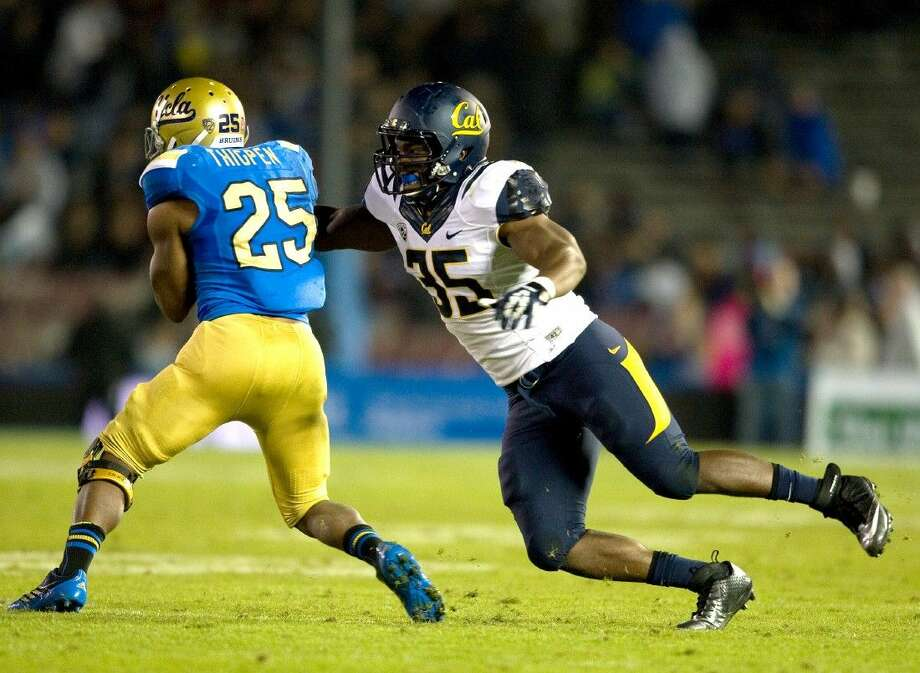 California's Ted Agu tackles UCLA's Damien Thigpen on Oct. 12, 2013, in Pasadena, Calif.