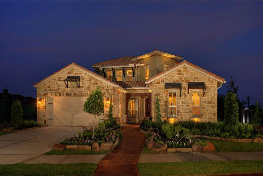 The new garden-style model from Sittlerle Homes, a Hill-Country-inspired design with an open concept floor plan and gourmet kitchen. Photo: Brian Tafelmeyer