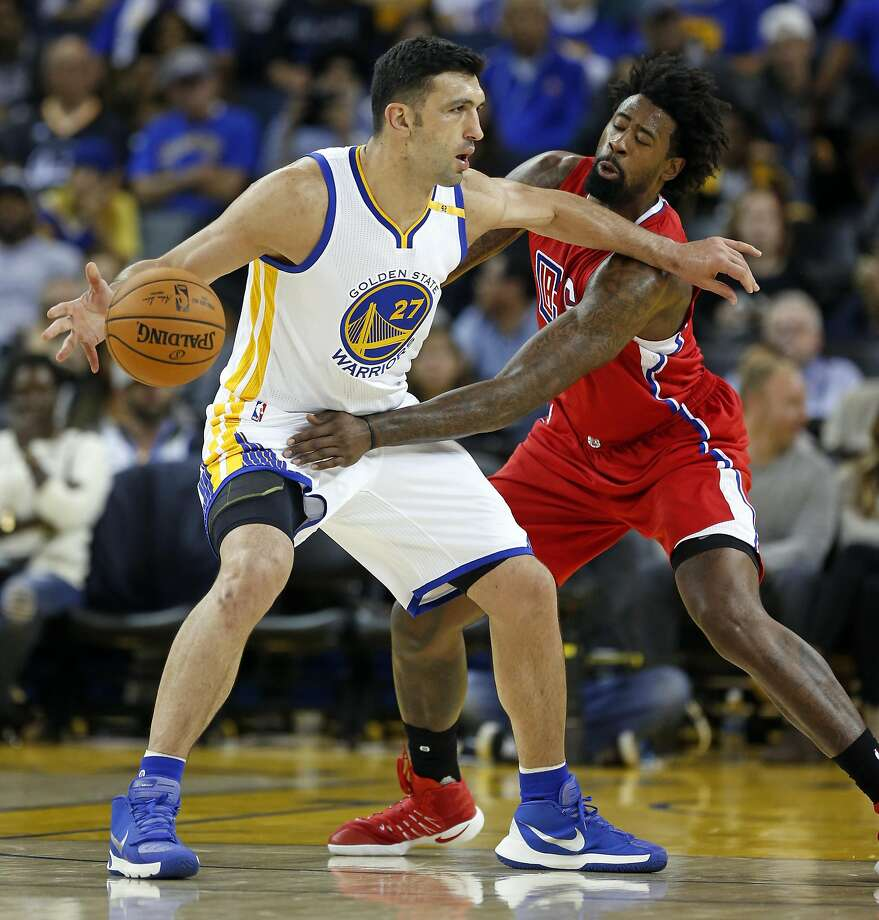 Golden State Warriors' Zaza Pachulia is fouled by Los Angeles Clippers' DeAndre Jordan in 3rd quarter during NBA Preseason game at Oracle Arena in Oakland, Calif., on Tuesday, October 4, 2016. Photo: Scott Strazzante, The Chronicle