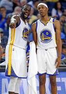 Golden State Warriors' Draymond Green talks with Patrick McCaw in 3rd quarter against Los Angeles Clippers during NBA Preseason game at Oracle Arena in Oakland, Calif., on Tuesday, October 4, 2016.
