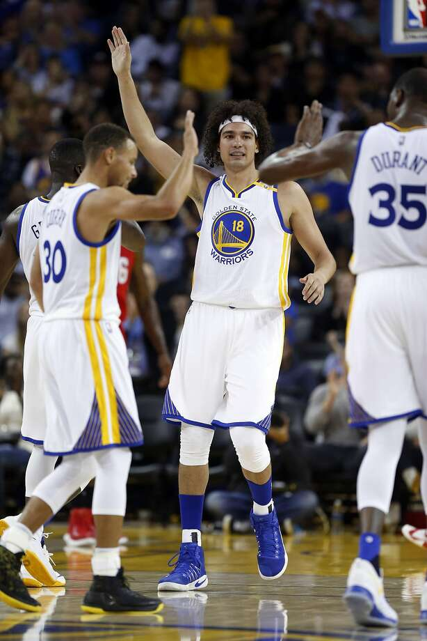 Golden State Warriors' Stephen Curry, Anderson Varejao and Kevin Durant celebrate 3rd quarter basket against Los Angeles Clippers during NBA Preseason game at Oracle Arena in Oakland, Calif., on Tuesday, October 4, 2016. Photo: Scott Strazzante, The Chronicle