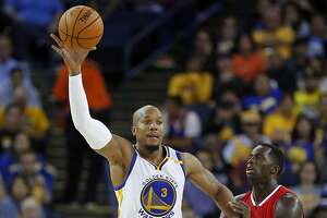 Golden State Warriors' David West catches pass against Los Angeles Clippers' Brandon Bass in 3rd quarter during NBA Preseason game at Oracle Arena in Oakland, Calif., on Tuesday, October 4, 2016.