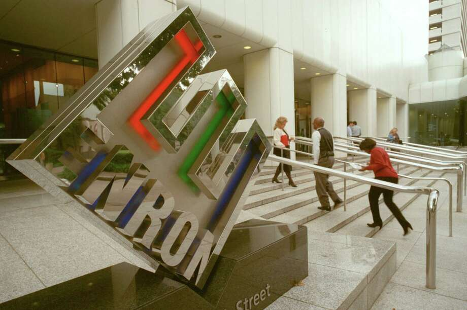 CONTACT FILED:  ENRON BUILDING-HOUSTON 10/31/2001--Exterior, Friday during the noon hour, of the Enron headquarters in downtown Houston with the slanted ``E'' logo. Photo by Steve Ueckert / Chronicle.     HOUCHRON CAPTION (01/12/2002):  Enron headquarters, in downtown Houston.   Viewpoints. Photo: Steve Ueckert, Staff / Houston Chronicle