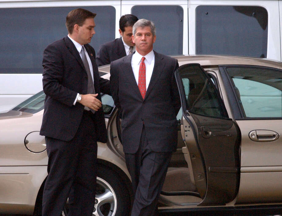 Former Enron Chief Financial Officer Andrew Fastow is escorted to the federal courthouse in Houston after surrendering to the FBI in 2002, shortly after Enron filed for bankruptcy. Photo: KARL STOLLEIS, STAFF PHOTOGRAPHER / HOUSTON CHRONICLE