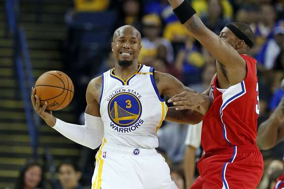 Golden State Warriors' David West battles Los Angeles Clippers' Paul Pierce in 3rd quarter during NBA Preseason game at Oracle Arena in Oakland, Calif., on Tuesday, October 4, 2016.
