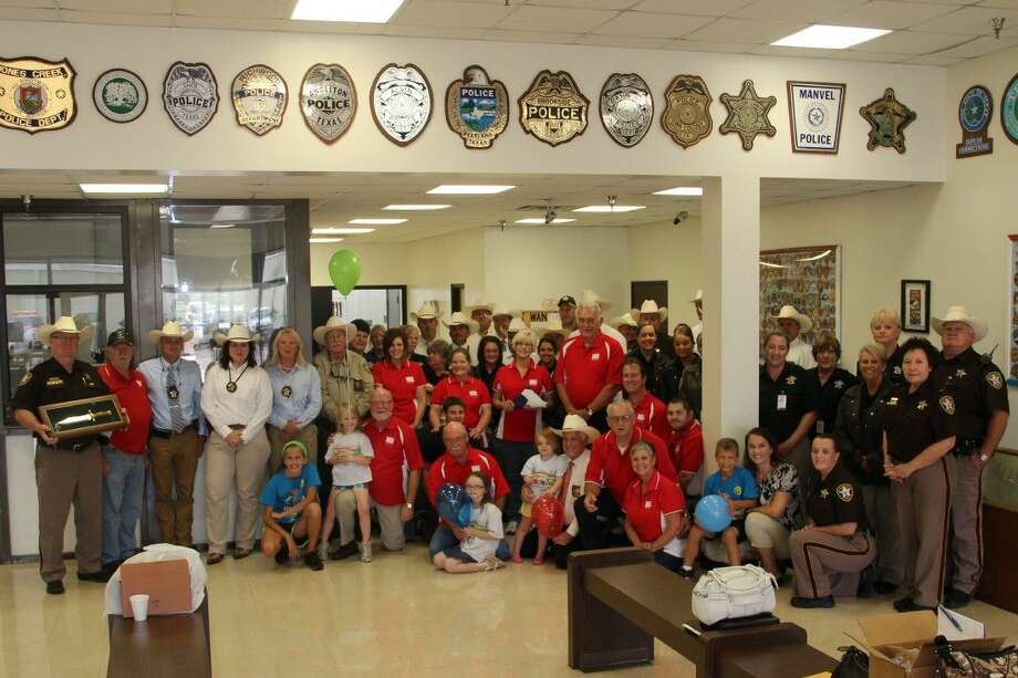 BACH families, members of the 2014 BACH Fun Fest Steering Team, and other Brazoria County Sheriff's Department, and Brazoria County Peace Officers' Association personnel gather to discuss plans for the upcoming 2014 BACH Fun Fest on Saturday, August 23, at the Alvin-Manvel Knights of Columbus Hall.