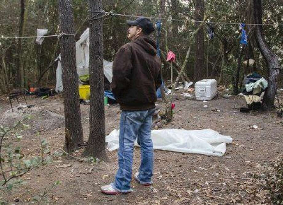 Cody Lacy, a volunteer, stands in a homeless camp while walking through the woods of Conroe looking for tent communities and homeless people during a Point-In-Time Count Jan. 23 to try to get an accurate number of homeless people in Montgomery County.