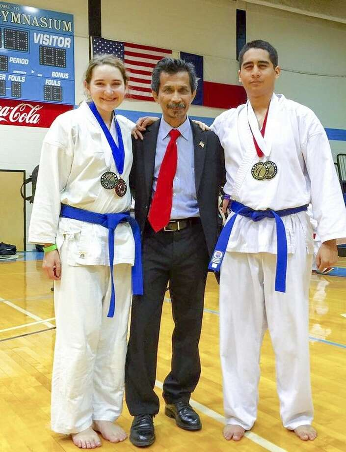 San Jacinto College martial arts instructor Deddy Mansyur, center, is flanked by San Jacinto College students Angela Olson and David Millan. Olson won a silver medal in Kata (form) and a bronze medal in Kumite (sparring). Millan won a gold medal in Kata and a silver medal in Kumite. Submitted photo.