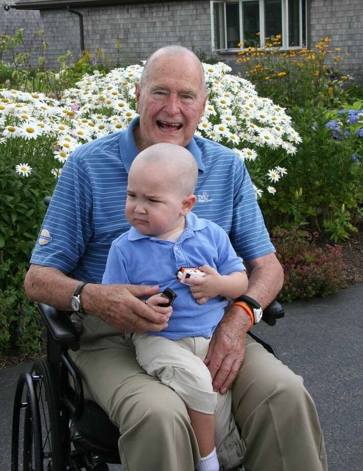 President Bush shaved his head in solidarity with a young cancer patient in 2013. Photo courtesy of the Office of President George H.W. Bush.