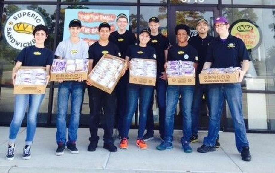 Staff at Which Wich in Atascocita pose with peanut butter and jelly sandwiches they prepared during last year's Spreading Party on National Peanut Butter and Jelly Day, April 2, 2015.