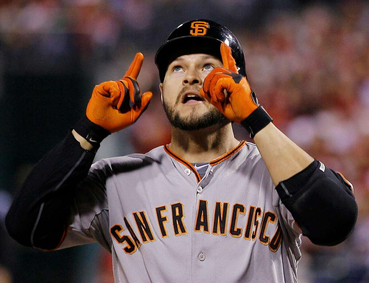 San Francisco Giants' Cody Ross reacts as he crosses home plate after hitting a home run during the fifth inning of Game 1 of baseball's National League Championship Series against the Philadelphia Phillies Saturday, Oct. 16, 2010, in Philadelphia. The home run was Ross' second of the game. (AP Photo/Matt Slocum)