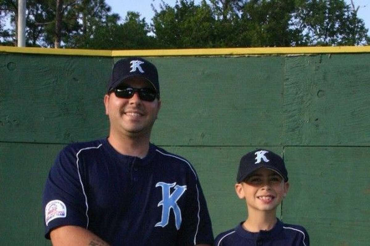 Jason Frost, right, with Coach Daniel Goss during this past baseball season.