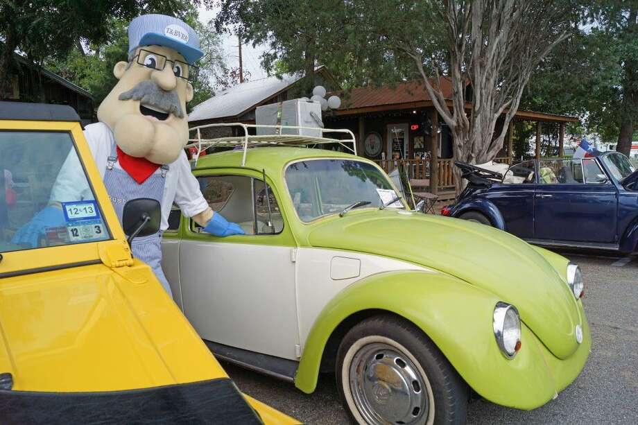 Tomball tourism mascot Rusty Rails loves on the classic VWs at Bugs, Brew & Barbecue. The event is set for Sept. 27. Photo: Submitted
