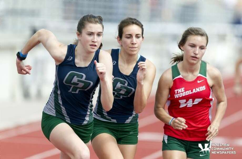 College Park and The Woodlands compete in girls 800 meter run during the finals of the 2015 District 16-6A track and field meet. Photo: Jason Fochtman