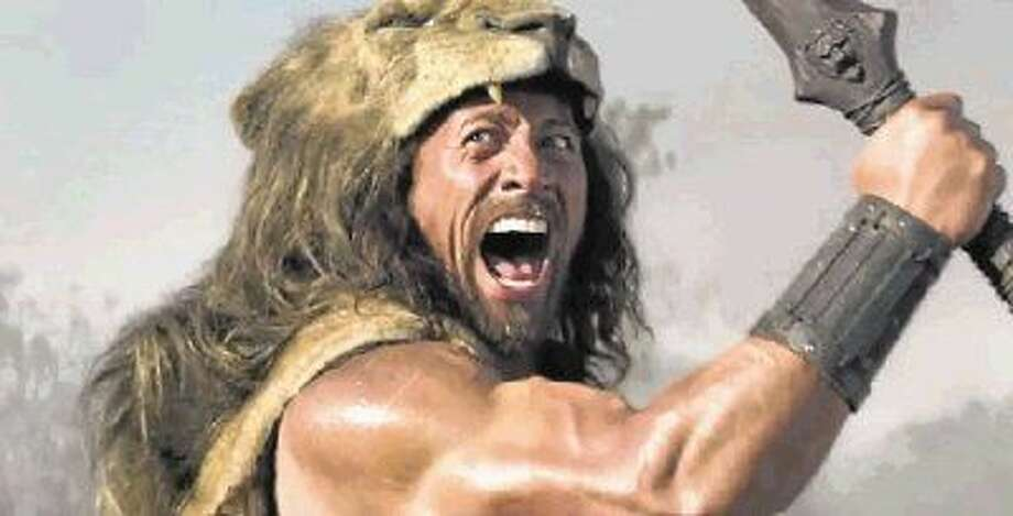 "Dwayne ""The Rock"" Johnson, takes on the iconic role of ""Hercules."" Danny Minton says Johnson has terrific comic timing and can be both physically imposing and goofy at the same time."