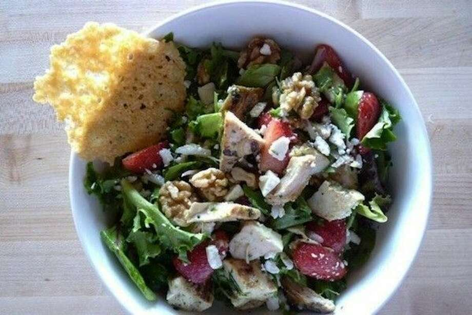 Farm Chicken Salad - Spring mix and romaine lettuce with strawberries, walnuts, red onion and feta cheese. Tossed with grilled chicken and our homemade sweet green dressing