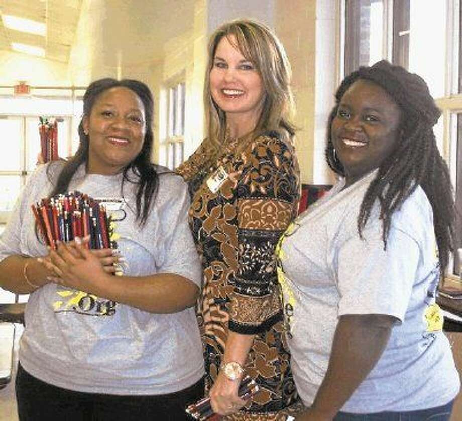 Community member Zann LaFrance (center) spends much of her time volunteering for a variety of local organizations, including the Cleveland Rotary Club, where she participates in events with fellow Rotarians, including Ashleigh Broussard and Eisha Jones. Photo: Stephanie Buckner