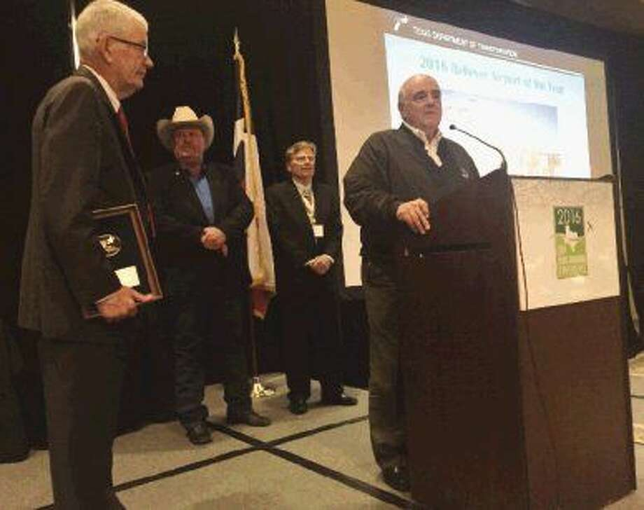 Precinct 1 Commissioner Mike Meador — the Commissioners Court liaison to the airport — speaks at the recent awards ceremony by the Texas Department of Transportation.