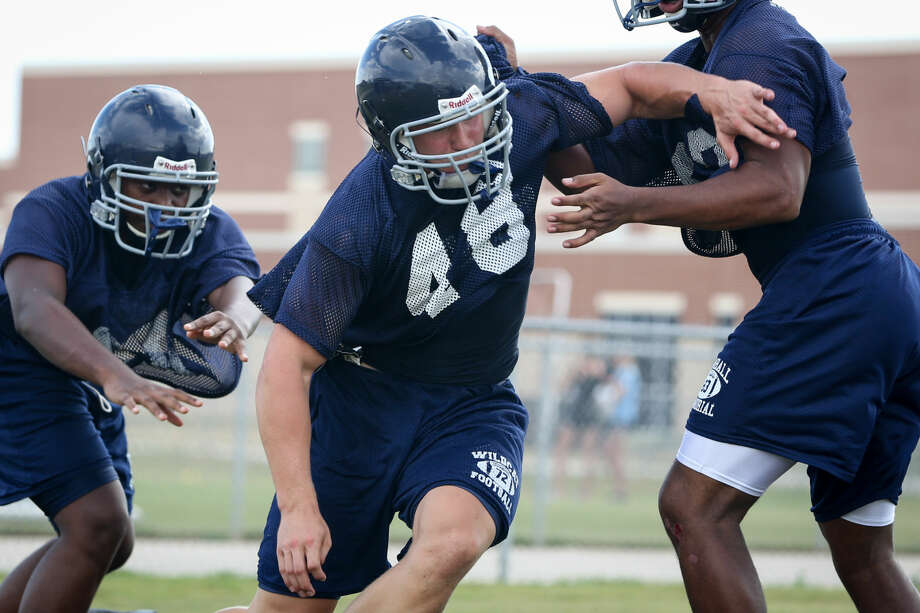 Tomball Memorial nose guard Reese Seggebruch performs practice drills on Tuesday, Aug. 5, 2014, at Tomball Memorial High School.