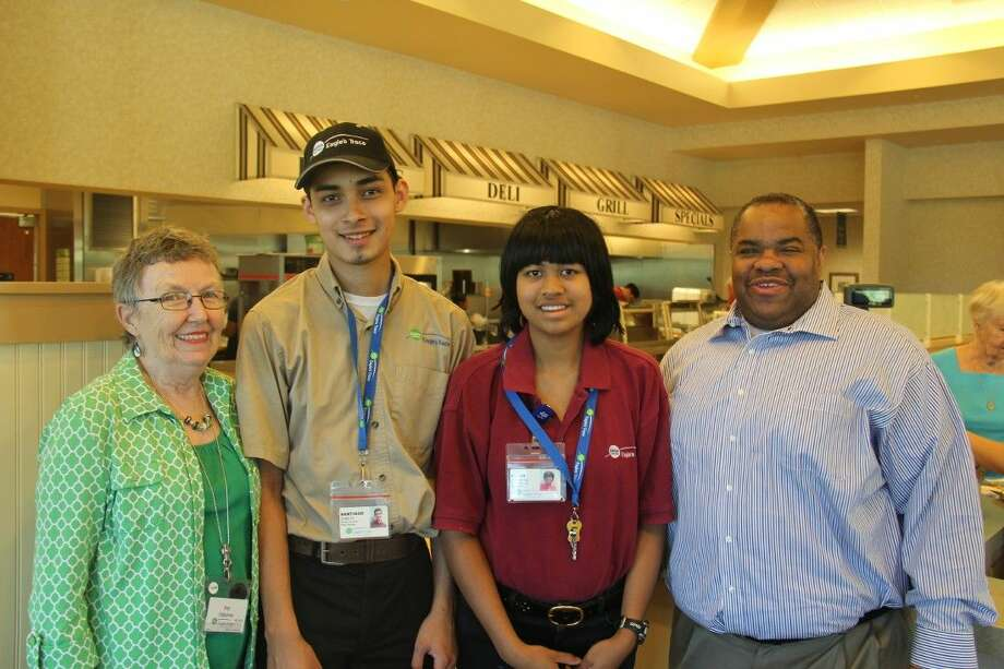 Eagle's Trace, the Erickson Living retirement community in West Houston, participates in the Spring Branch ISD program for special needs students called Transitioning On Promotes Success (TOPS). Its original architect, Pat Osborne, resides at Eagle's Trace. Pictured from left are Osborne, Santiago Zubieta (TOPS student), Alexa Urbantke (TOPS student) and George Jones (Service Manager) in the community's Roost Café