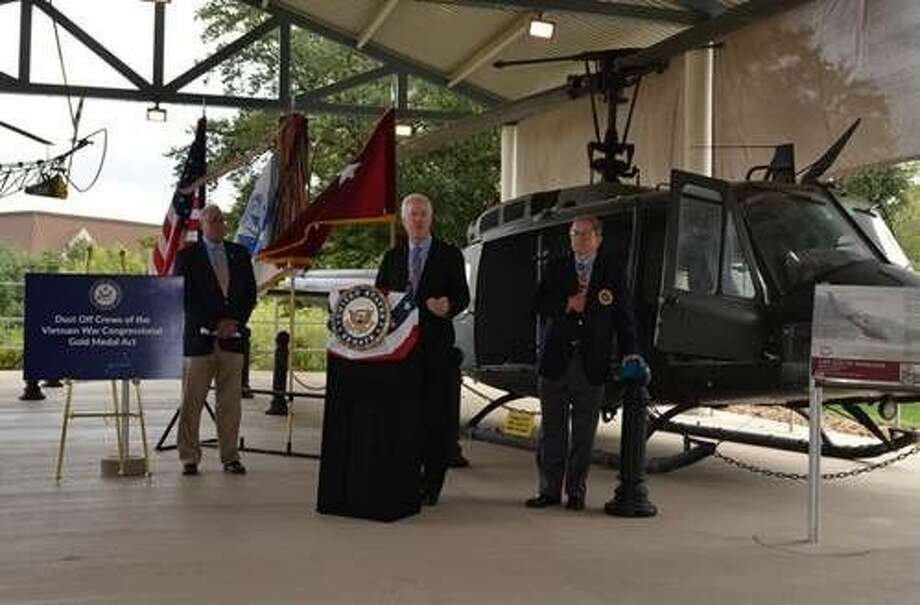 Sen. Cornyn with Major General Patrick Brady, a former Dust Off pilot who earned the Medal of Honor for his service during the Vietnam War, at Fort Sam Houston on Veterans Day last year. Behind them is a UH-1 'Huey' helicopter.