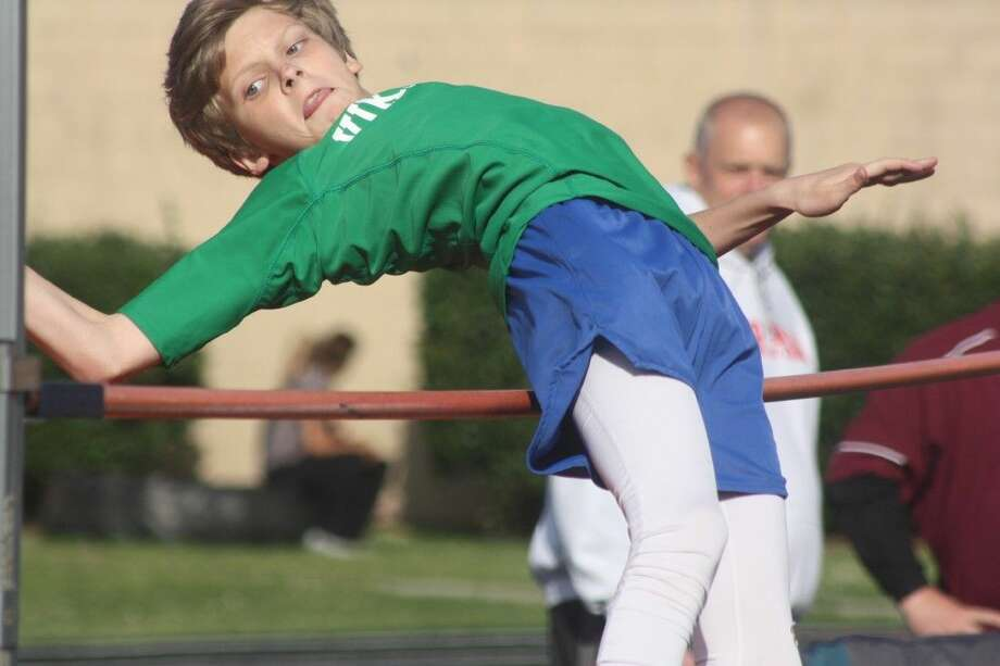 Fairmont Junior High's Tucker Wennagel attempts to clear the bar in the high jump competition at the district championship meet for the Bay Area League schools at Bulldog Stadium last week. The Viking seventh grader came close on this attempt, but the bar wouldn't cooperate, coming down on all three tries. Photo: Robert Avery