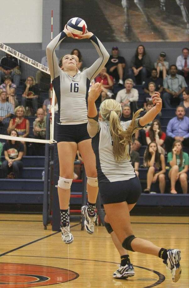 College Park's Hannah Erwin (16) sets the ball for Macey Rabson during a match against Klein Collins on Tuesday at College Park High School. To view or purchase this photo and others like it, visit HCNpics.com.