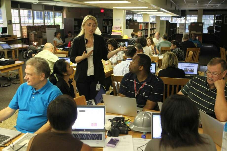 Technology Instructor Diana Bidulescu works with teachers during a cyber safety training at the High School for Law Enforcement and Criminal Justice on Wednesday, Aug. 13, as Houston ISD Police and Information Technology departments unveiled a new tool to educate students, parents, and the community on the importance of cyber safety. Photo: Alan Warren