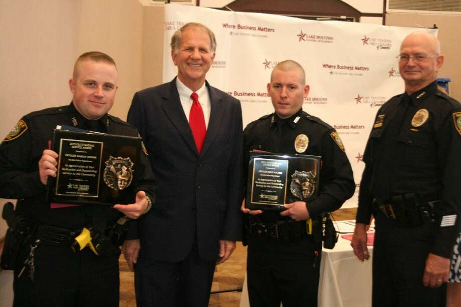 Humble Police Department Officers Damian Brown and Kole Holden with Congressman Ted Poe, center, and Humble Police Chief D. Dawes, far right, were honored as the department's Officers of the Year at the annual Lake Houston Area Chamber of Commerce's Hometown Heroes Peace Officers and Firefighters of the Year luncheon Tuesday, March 29, 2016.