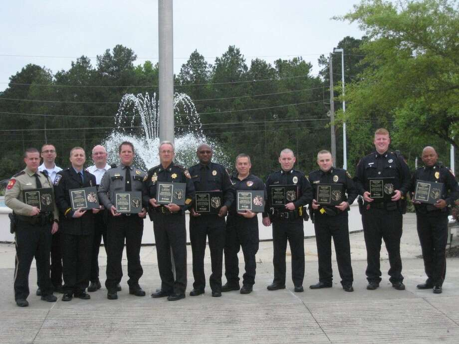 Honoring local peace officers and firefighters/ems workers, who run to a scene when called instead of away, was the ultimate purpose of the Lake Houston Area Chamber of Commerce's annual Hometown Heroes luncheon Tuesday, March 29, 2016.