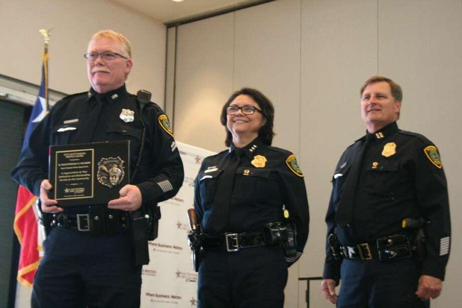City of Houston Police Department-Kingwood Division Senior Police Officer Billy Willoughby, left, with HPD interim chief Martha Montalvo, center, and HPD-Kingwood Captain Mark Fougerousse, was honored as the Officer of the Year at the annual Lake Houston Area Chamber of Commerce's Hometown Heroes Peace Officers and Firefighters of the Year luncheon Tuesday, March 29, 2016.