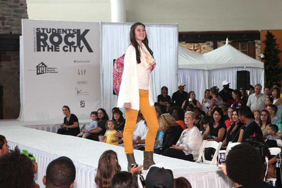 A high school model walks the runway wearing back to school clothes during the Students Rock the City fashion Show at Memorial City Mall. Photo: Alan Warren
